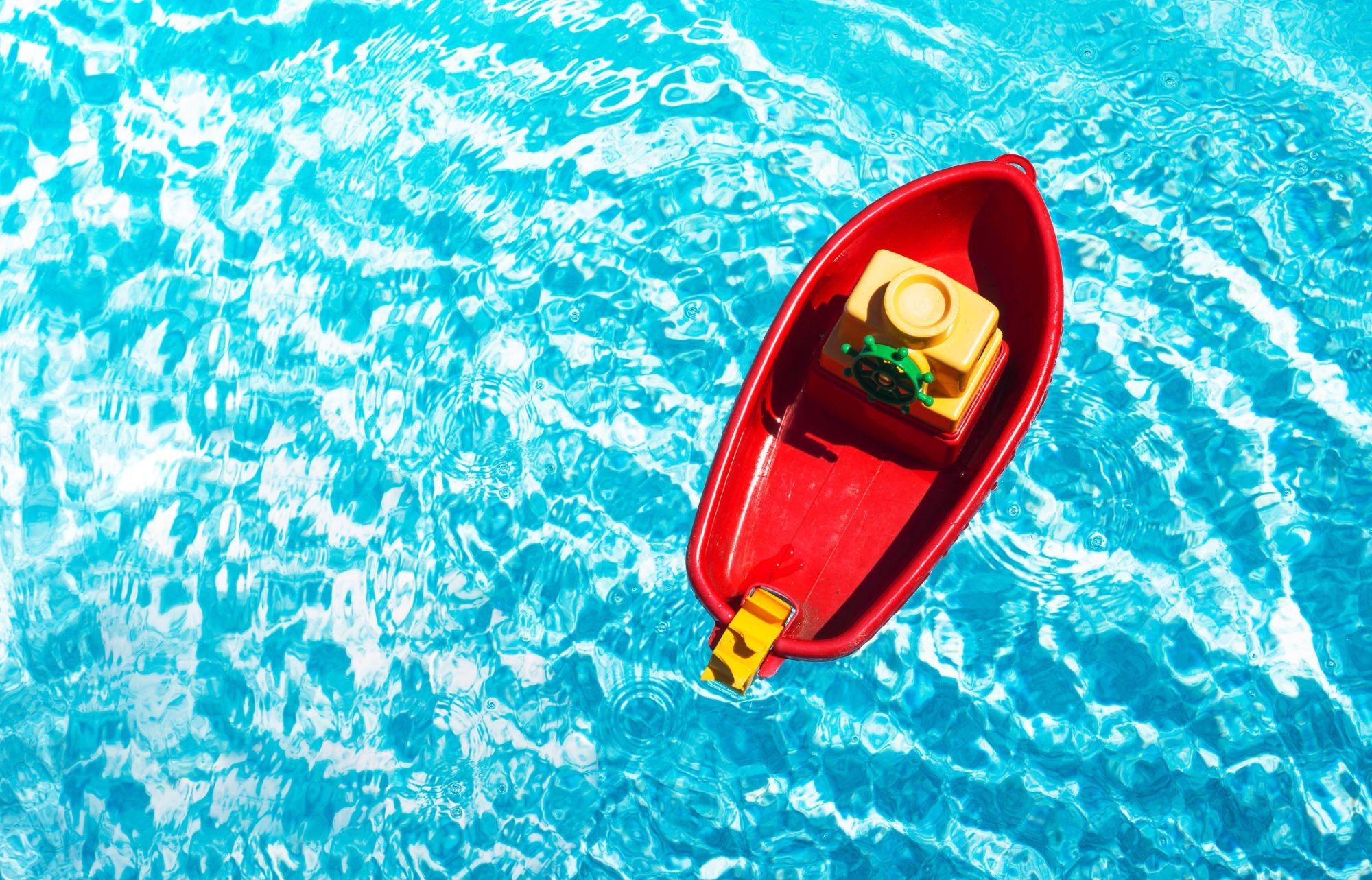 red-toy-boat-in-a-swimming-pool-1625476147.jpeg
